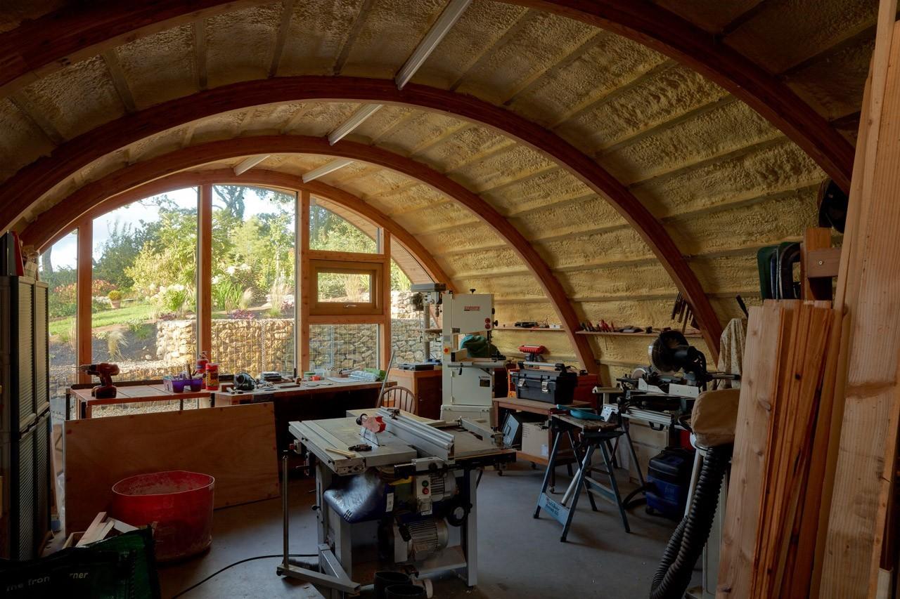 The curved glulam workshop shed.